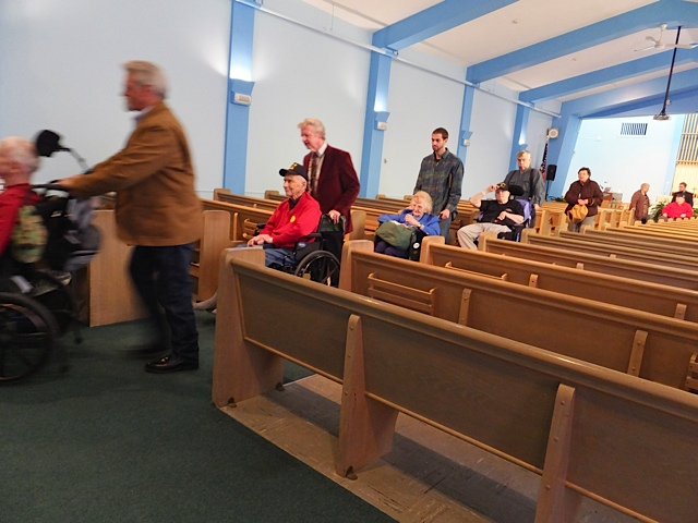 """Departing Heroes"": Some of the veterans of Togus Anglican Chapel depart after the Eucharist service in Augusta, Maine. One veteran in the photo served on the USS Nevada in Pearl Harbor during World War II."
