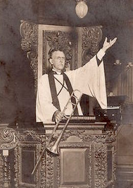 The Rev. Carlile at the pulpit